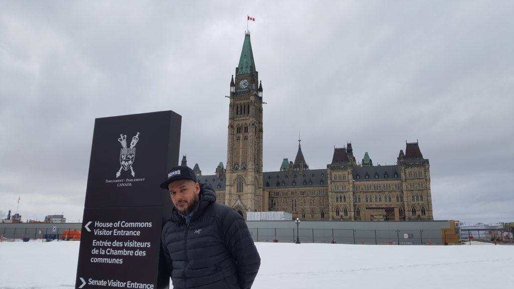 Adrian Sutherland in front of the Parliament Building in Ottawa