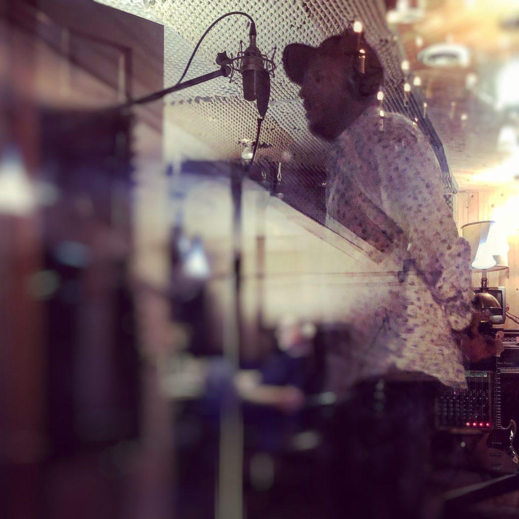 Adrian Sutherland in the recoring studio